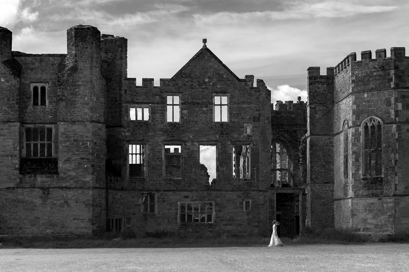 Bride and Groom in front of ruins at The Walled Garden Cowdray