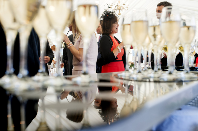 Guests reflected in bar top at wedding reception at East Sussex wedding