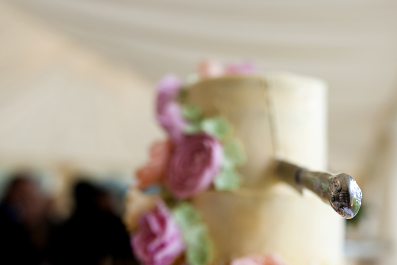 Wedding cake with knife stuck in it