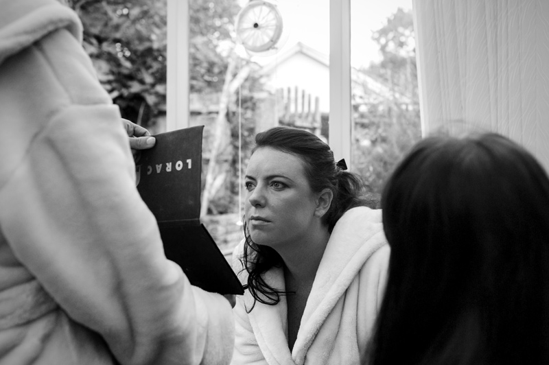 Bride checking make up in mirror