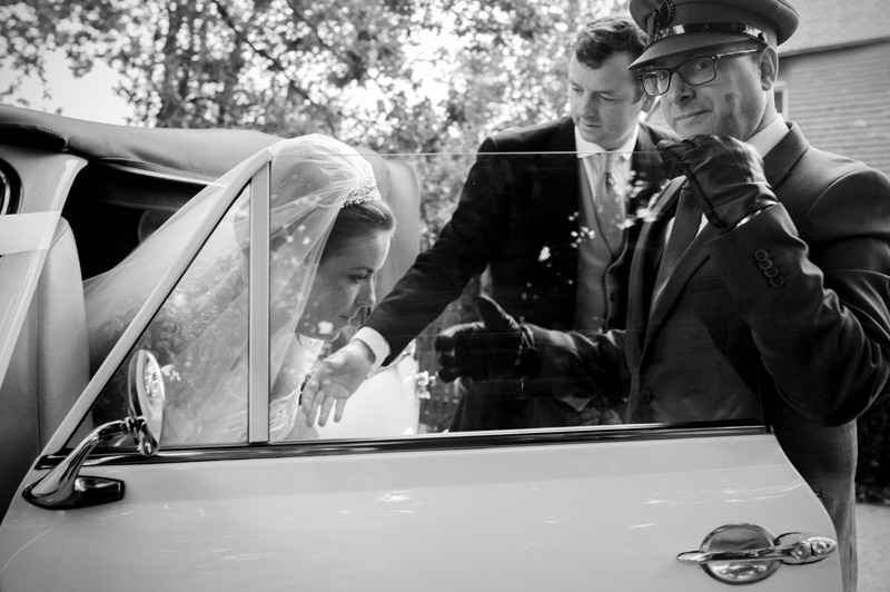Bride alighting from wedding car