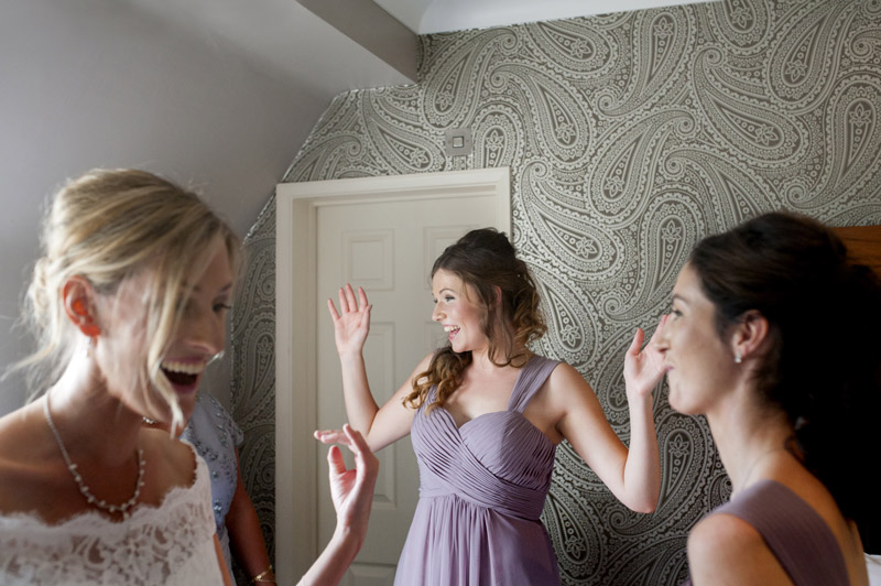 Bride and bridesmaids laughing at Bannatynes Hotel Hastings wedding