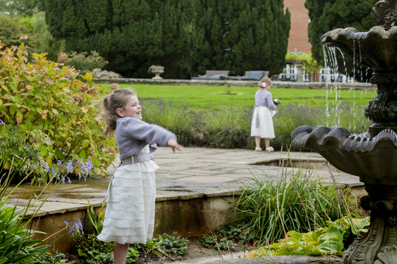 Little bridesmaids playing outdoors at Bannatynes Hotel Hastings wedding