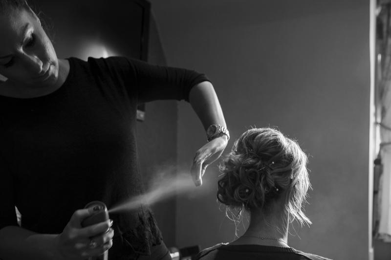 Bride hair spray getting ready