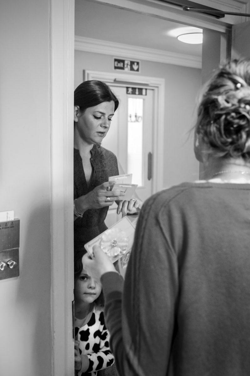 Bride opening hotel room door