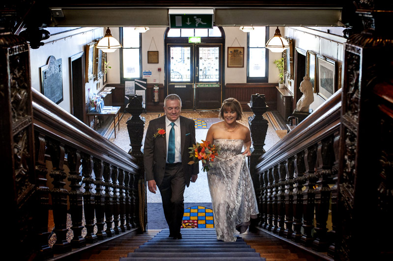 Bride and father ascending stairs for Lewes Town Hall wedding