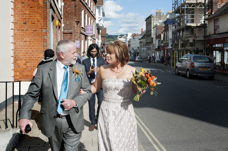 Bride and father in law walking through Lewes