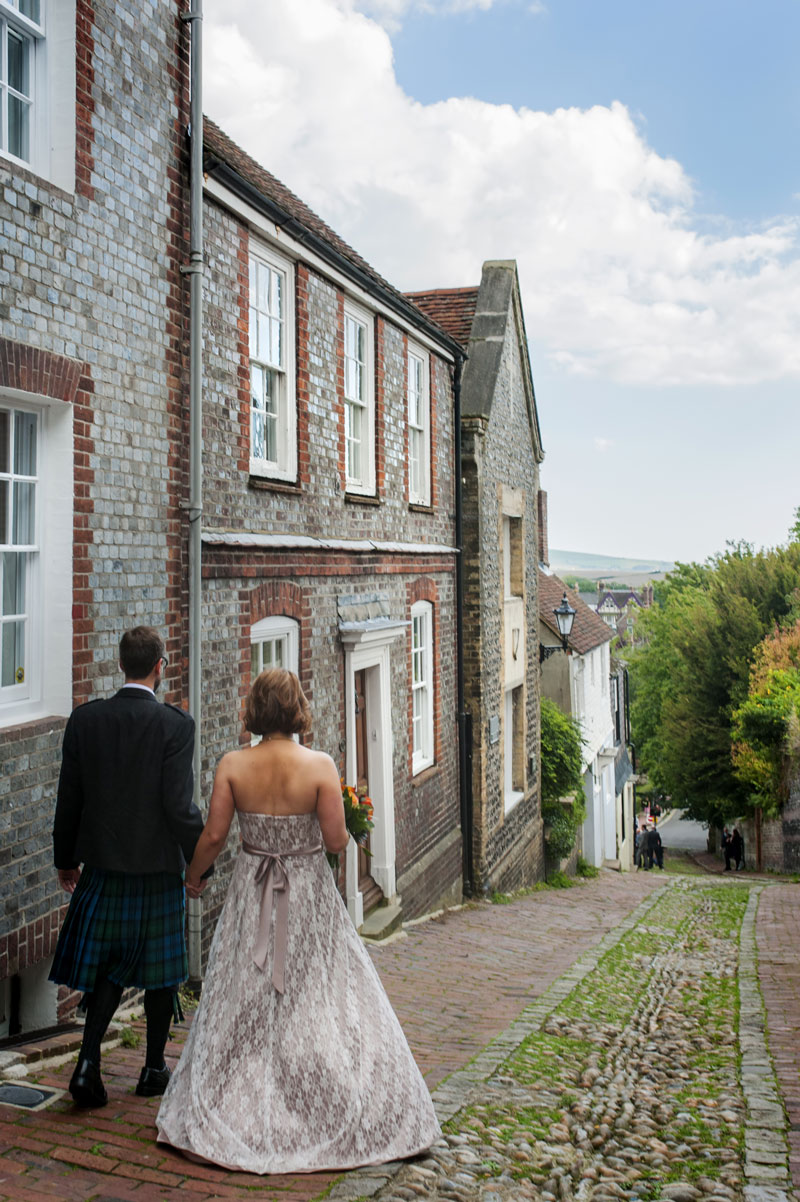 Bride and Groom walking down cobbled street in Lewes