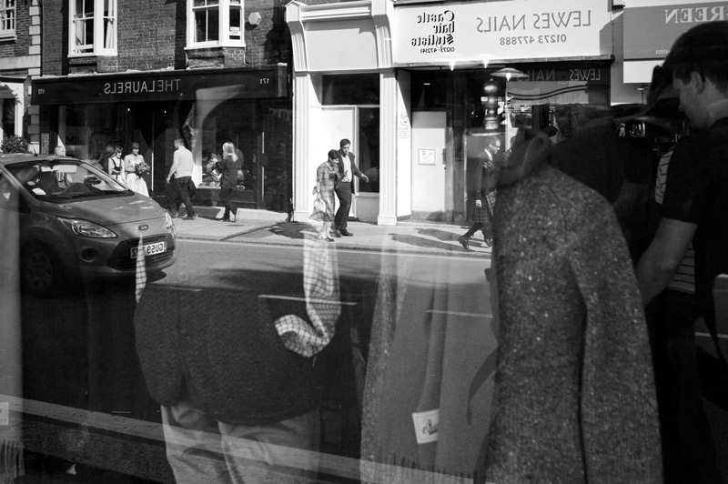Wedding party reflected in shop window