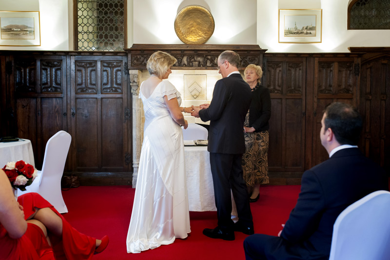 Exchanging rings at Smallfield Place wedding