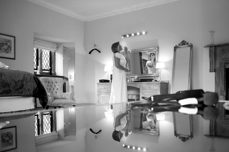Bride in bedroom at Smallfield Place wedding