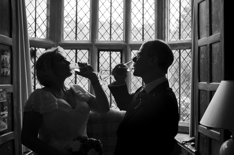 Couple drinking champagne Smallfield Place wedding