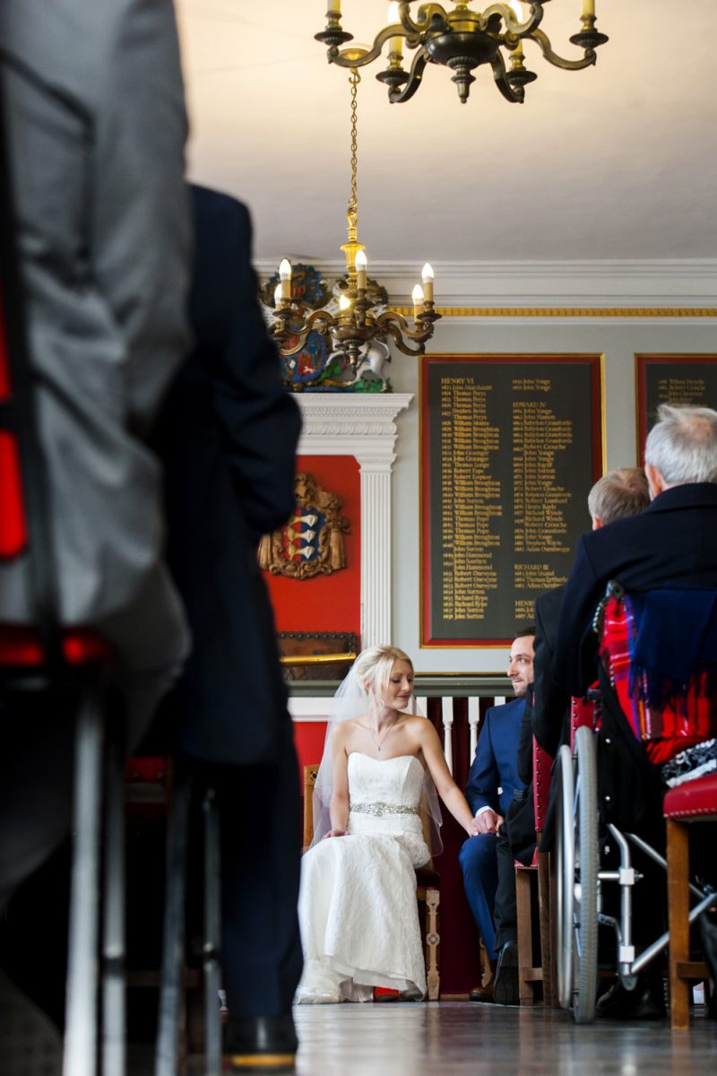 Bride holding grooms hand at Rye Town Hall wedding