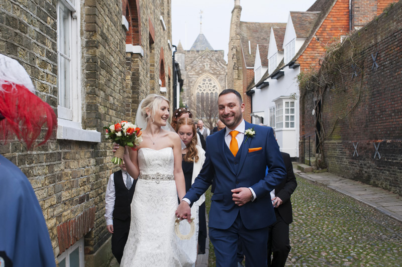 Newleyweds walking through Rye