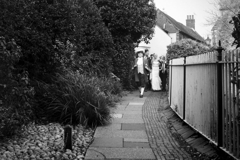 Wedding party walking to Mermaid Inn after Rye Town Hall wedding