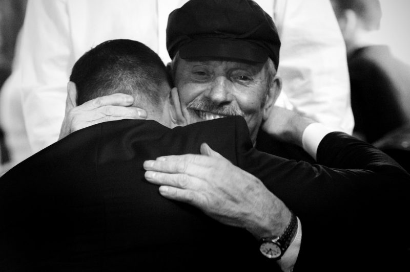 Father hugging groom
