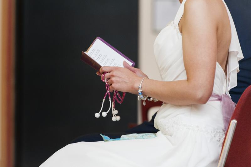 Taplow Court wedding - bride's hands with beads