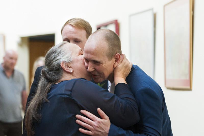 Relative hugging groom