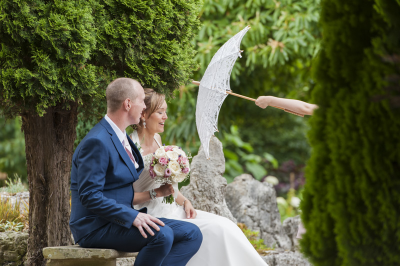 Taplow Court wedding - bride and groom and ornate umbrella poking into the picture