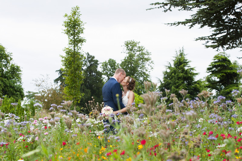 Taplow Court wedding - bride and groom kiss in grounds