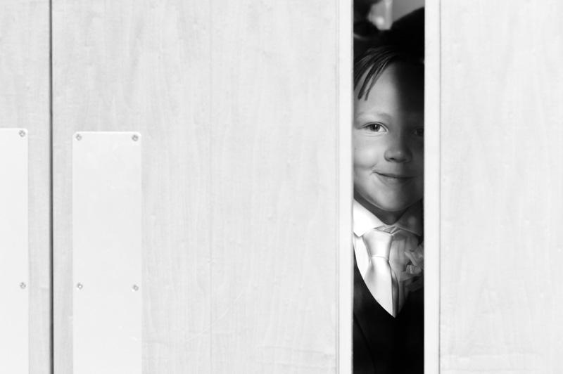 Taplow Court wedding - boy peeking through window