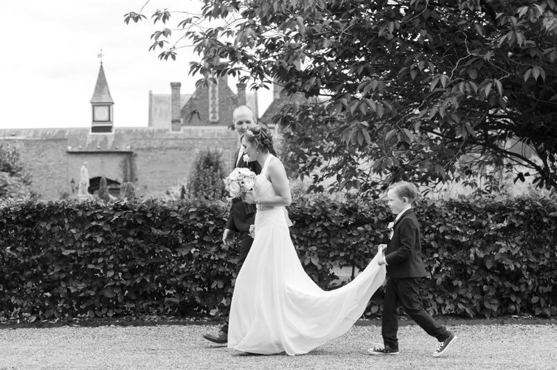 Taplow Court wedding - son holding bride's dress