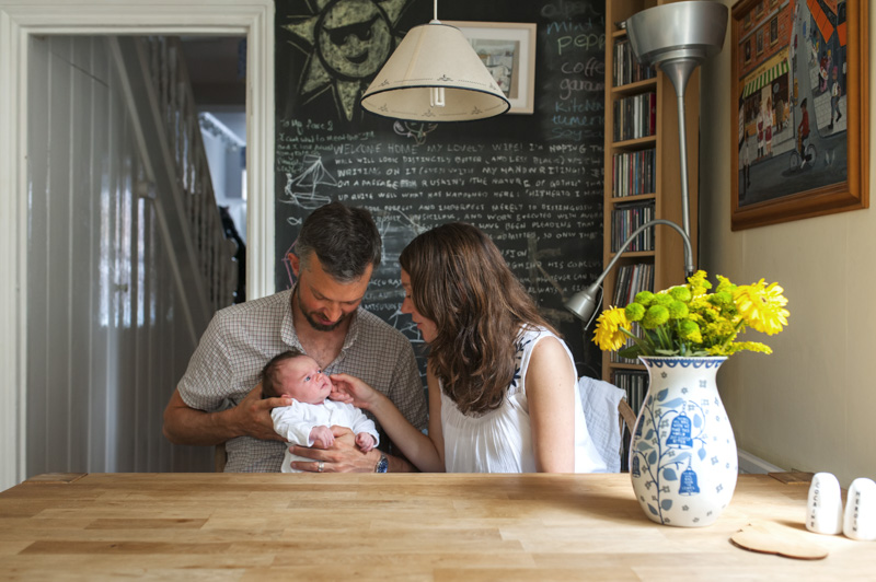 Young family in the kitchen by Sussex family photographer James Robertshaw