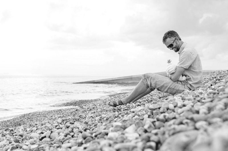 Father and baby on the beach by Sussex family photographer James Robertshaw
