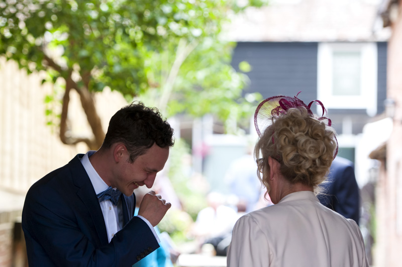 Plough at Leigh wedding - groom laughing with guest