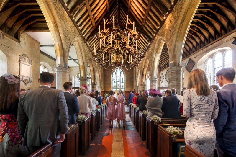 Plough at Leigh wedding - bridal party coming into church