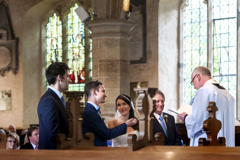 Plough at Leigh wedding - couple exchanging rings
