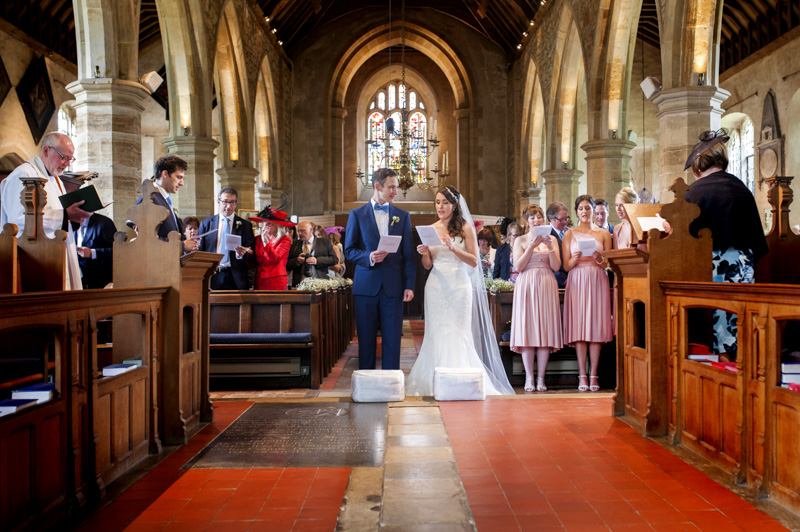 The Plough Leigh wedding - couple singing in church