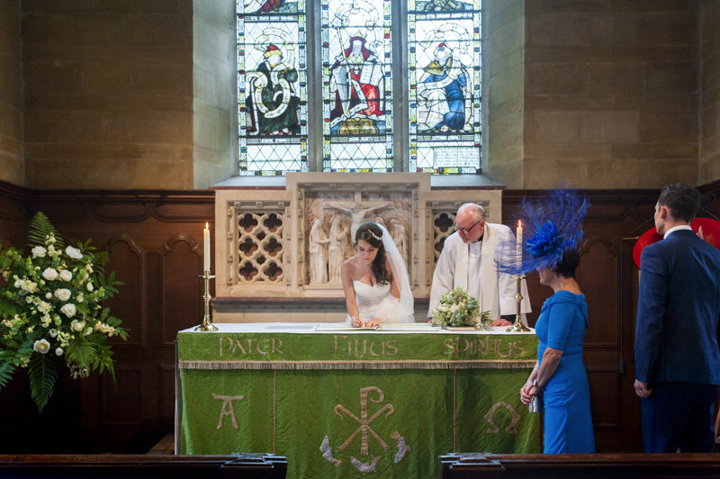 Plough at Leigh wedding - bride signing register