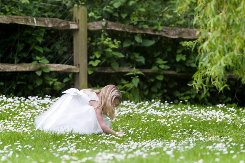 Plough at Leigh wedding - girl picking daisies