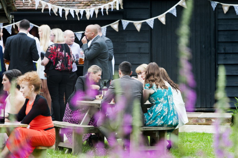 Guests in the garden at wedding reception