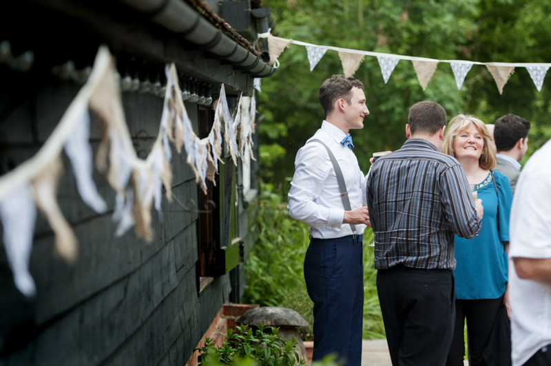 Groom relaxing with guests at the Plough, Leigh