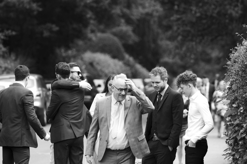 Plough at Leigh wedding - groom greeting guests