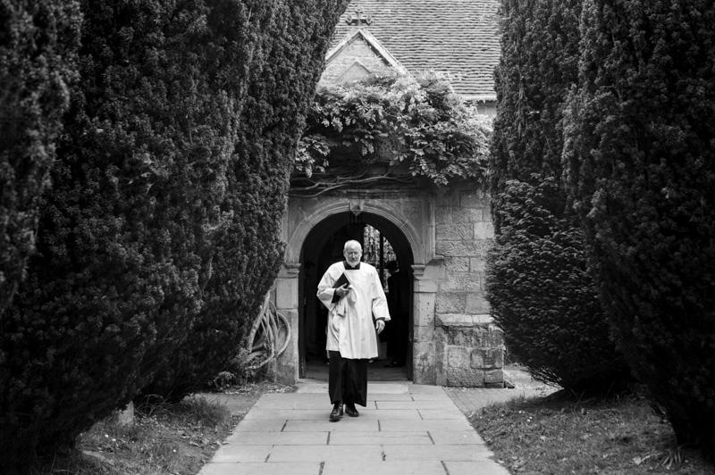 Plough at Leigh wedding - vicar outside church