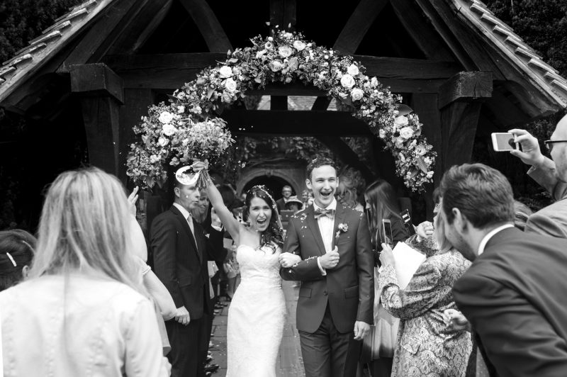 Bride and groom coming out of Chiddingstone church