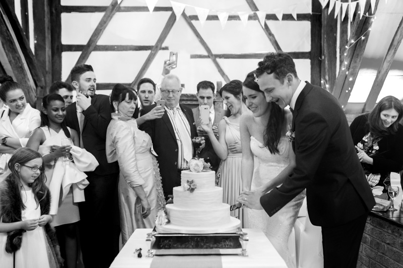 Plough at Leigh wedding - cutting the cake