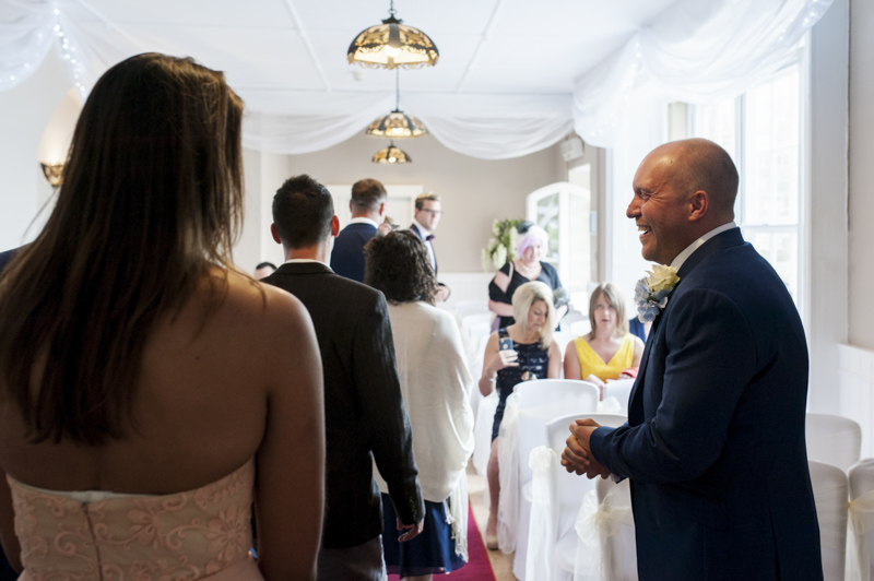 Crowhurst Park wedding - groom greeting guests