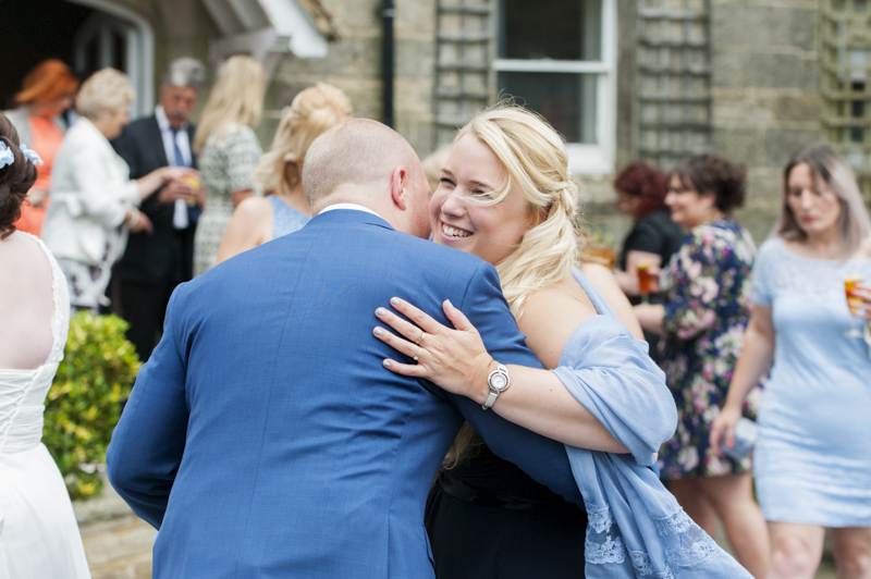 Crowhurst Park wedding - groom hugging guest