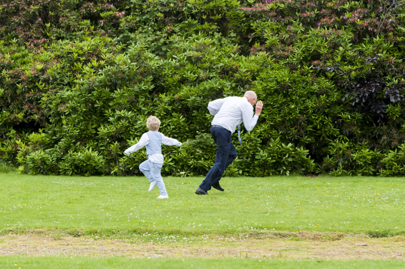 Crowhurst Park wedding grandfather and grandson running