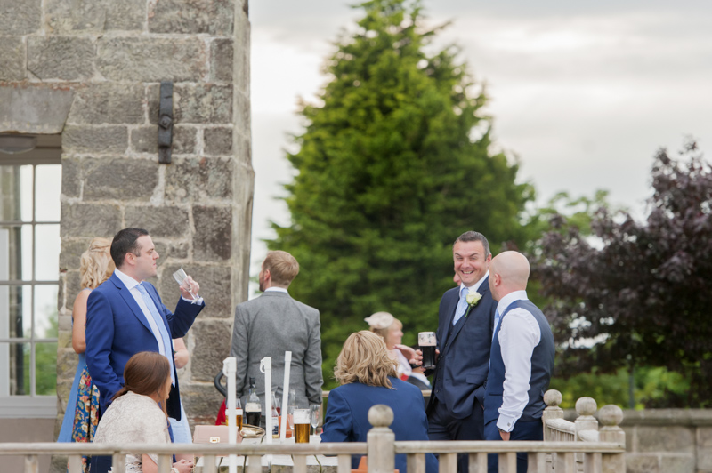 Crowhurst Park wedding - guest laughing outdoors