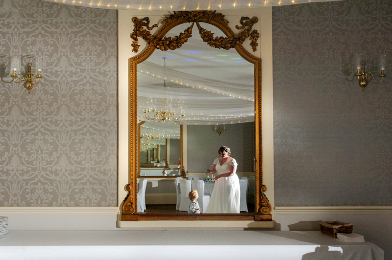 bride and son reflected in mirror
