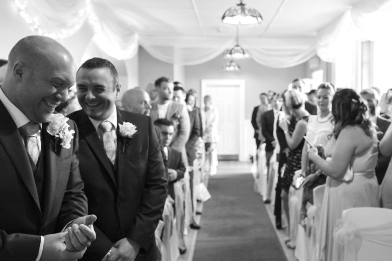 Crowhurst Park wedding - groom and best man laughing