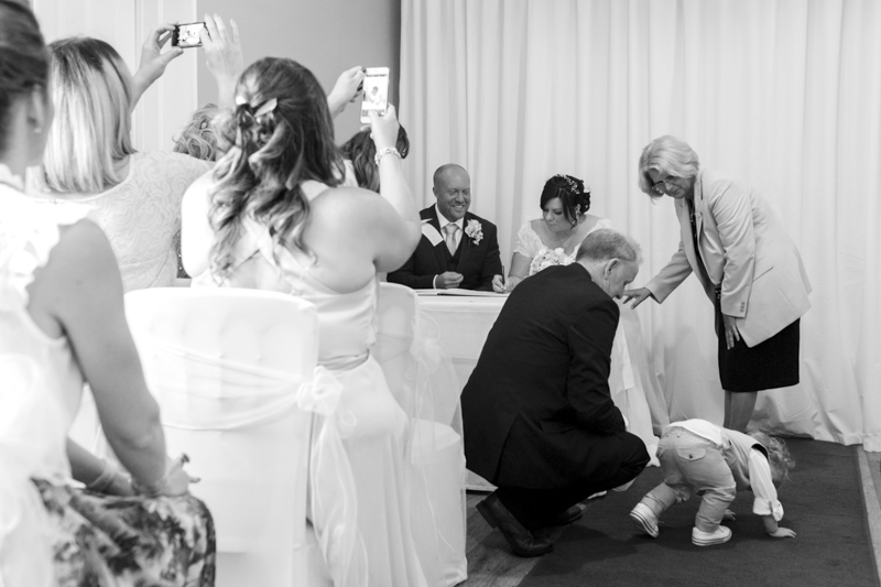 Crowhurst Park wedding - signing the register