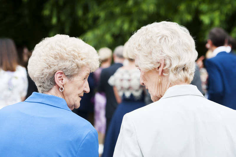 Elderly ladies looking at each other