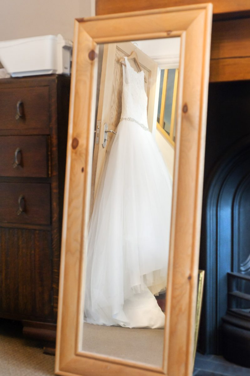 Manor Barn wedding - Wedding dress reflected in mirror