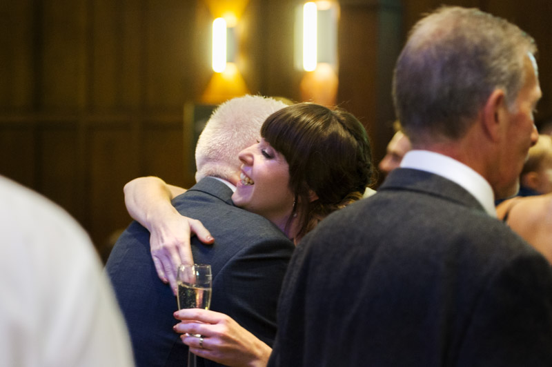 Bride hugging guest at wedding reception
